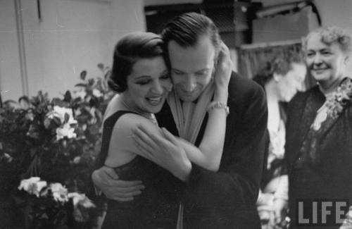 Actress Ina Claire hugging Cecil Beaton at the opening of Once Is Enough-- circa 1937