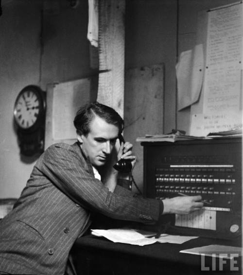 Photographerdesigner Cecil Beaton at the switchboard doing his duty as an Air Raid Precautions operator on the estate of Lord and Lady Pembroke-- circa 1940